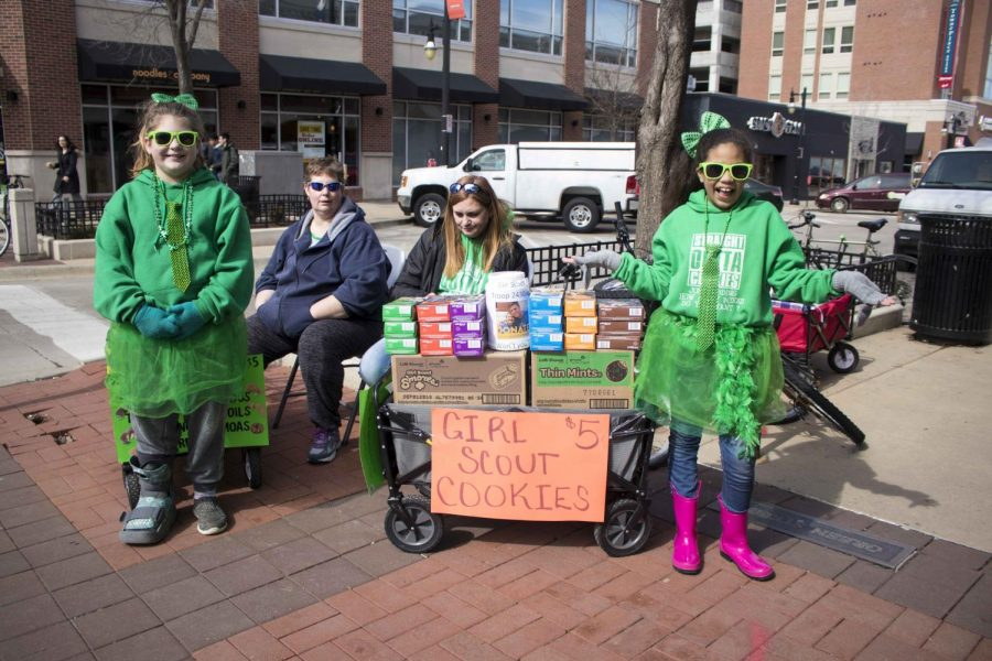 Girl Scouts set up camp at the intersection of Green Street and 5th Street to catch the attention of Unofficial celebrators on the street on March  2nd.