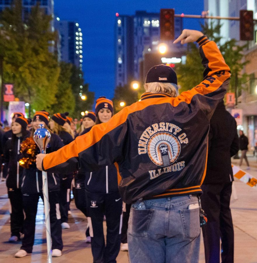 A man shows off his Chief Illiniwek jacket at the 2017 Homecoming Parade. The University is suing Ted O'Malley for associating the University with the Chief in using the symbol.