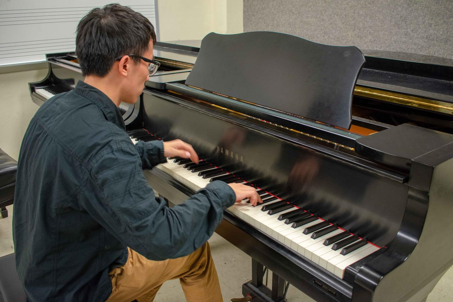 Bowen Song, senior, practices between his classes Thursday at the Music Building. Newly admitted students in the School of Music can now shadow current students.