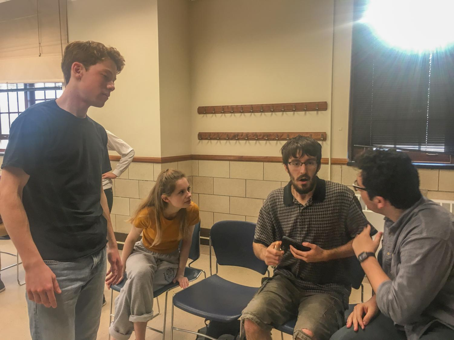 "Remington Sheehan, Kelsey Woodbury, Dan Zolecki, Justin Dirr rehearse for ""Sign Here, Please."" the play's first show will premier on Firday April 20 the Community United Church of Christ."
