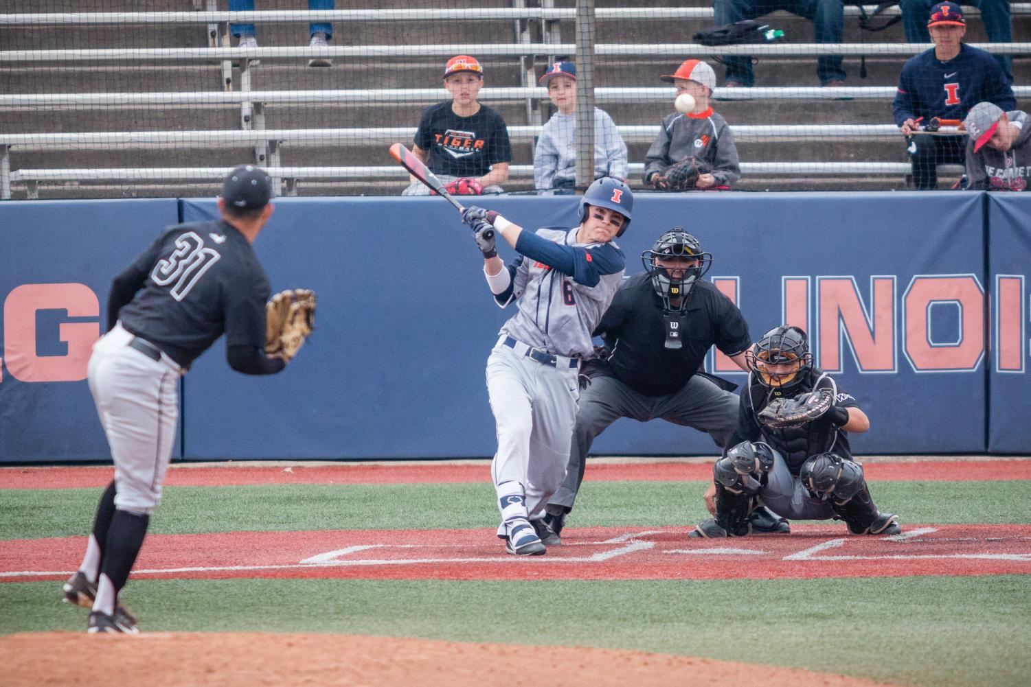 Illinois infielder Michael Massey (6) hits a double to left center field during the game against Grand Canyon at Illinois Field on Saturday, April 21, 2018. The Illini won 3-2.