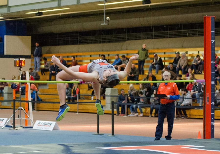 Brenda Kendziera clears the high jump bar for Illinois during the Orange and Blue Open on Saturday, February 17, in the UI Armory.