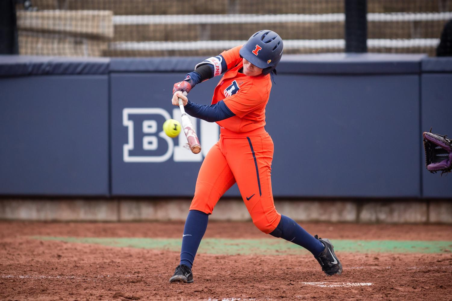 Illinois outfielder Maddi Doane (14) hits the ball during the game against Northwestern at Eichelberger Field on Wednesday, Mar. 28, 2018.