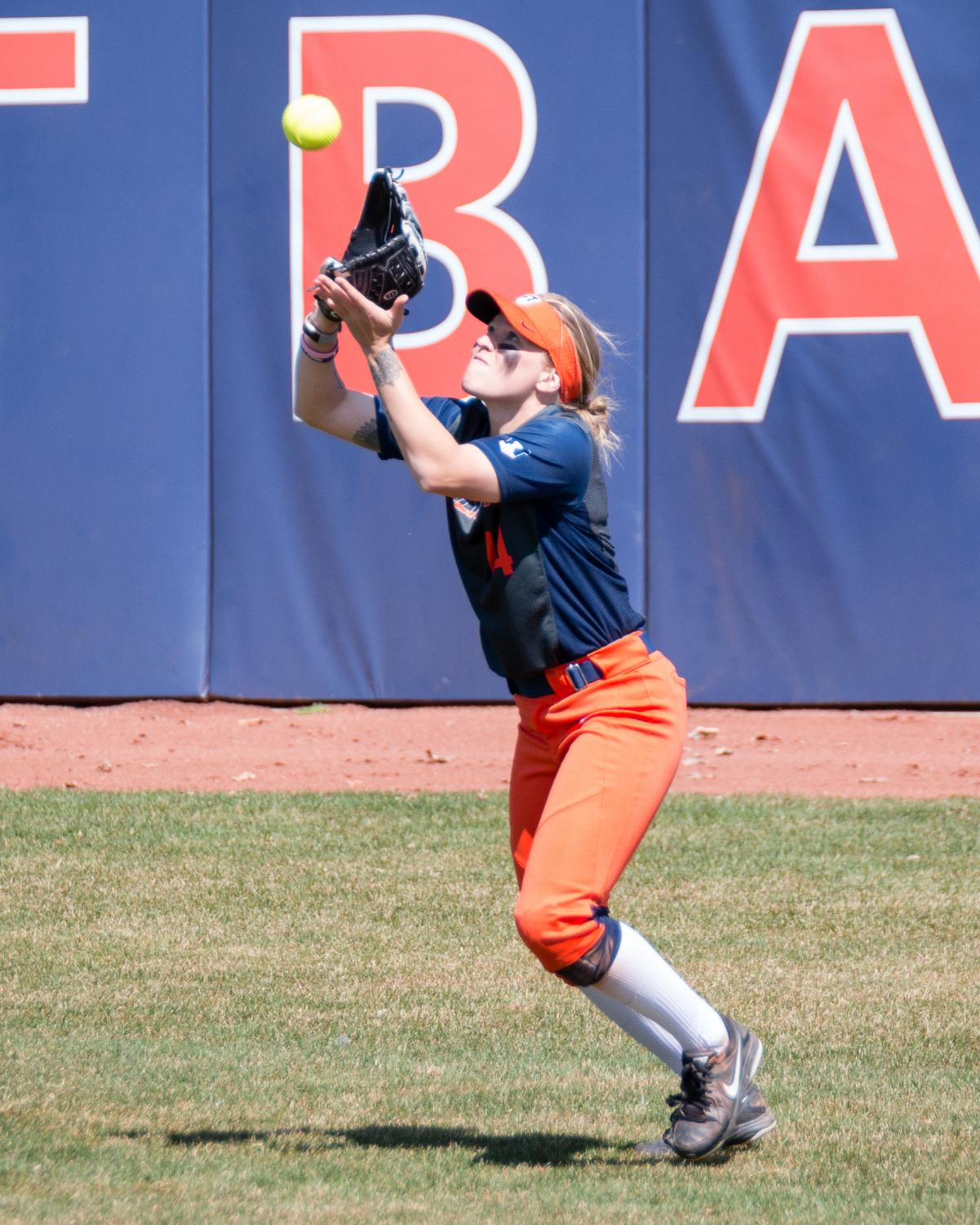 Illinois right fielder Maddi Doane catches a fly ball during the game against Minnesota at Eichelberger Field on April 1. The Illini won 4-3.