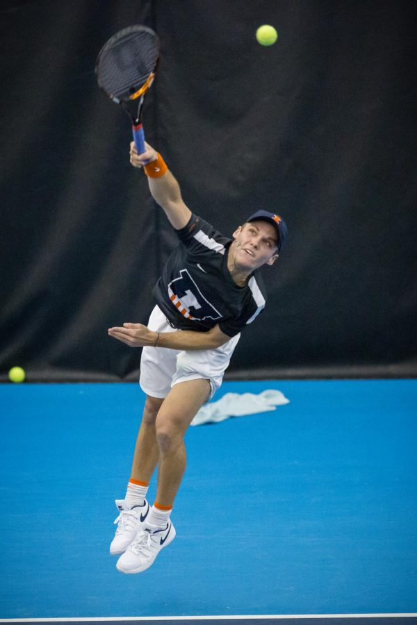 Illinois' Zeke Clark serves the ball during the match against California at the Atkins Tennis Center on Feb. 9. The Illini won 4-0.