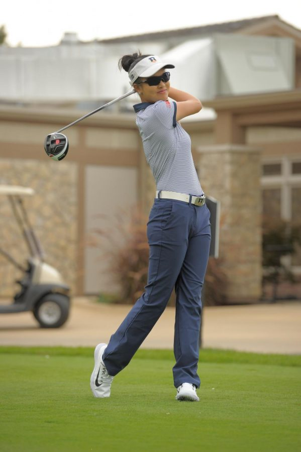 Senior Bing Singhsumalee hits a ball at the Ohio State University Golf Club in Columbus, Ohio in April 2018. Singhsumalee, the lone senior on the team, anticipates unpredictable conditions on the course this year despite having played on the same course in the past.