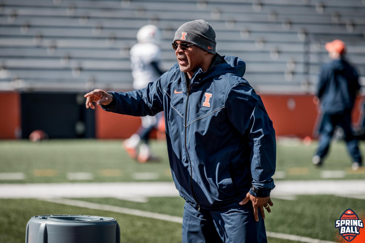 Illinois safeties coach and passing game coordinator Gill Byrd helps direct football practice. Byrd joins tight ends coach Cory Patterson and defensive line coach Austin Clark as one of the team's newest coaching additions.