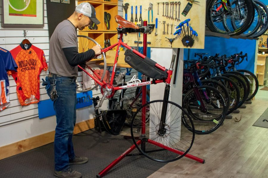 Paul Ignacio, sales manager of Neutral Cycle, works on a customer's repair on Monday at their Green Street store.
