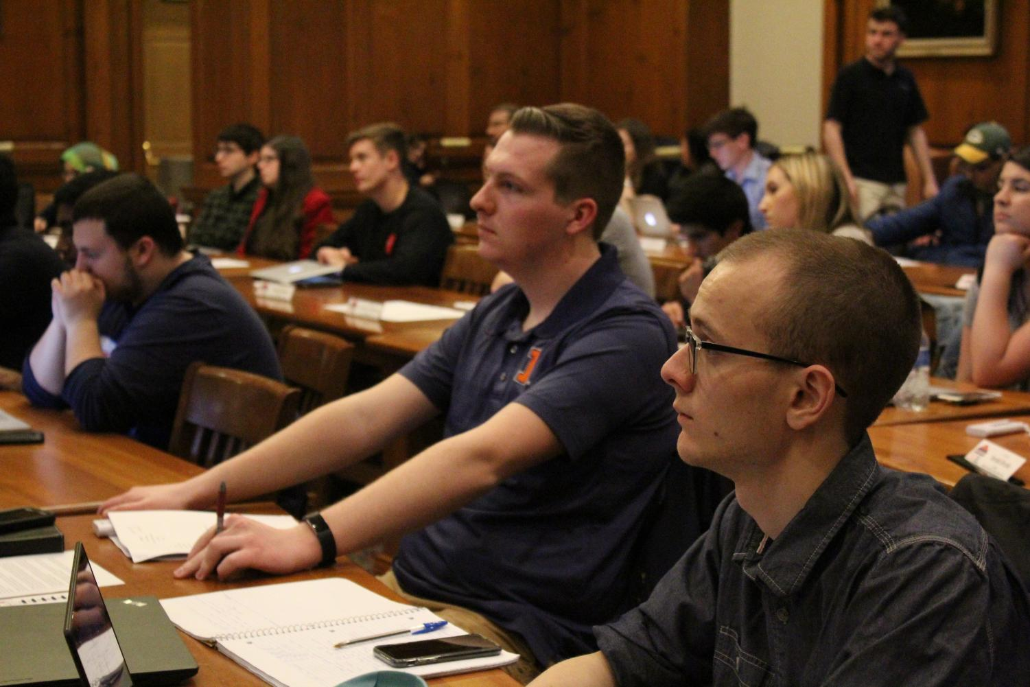 Members of the Illinois Student Government sit at their last meeting of the current assembly. They instituted a grade point average requirement and compensation resolution for after Spring 2019.