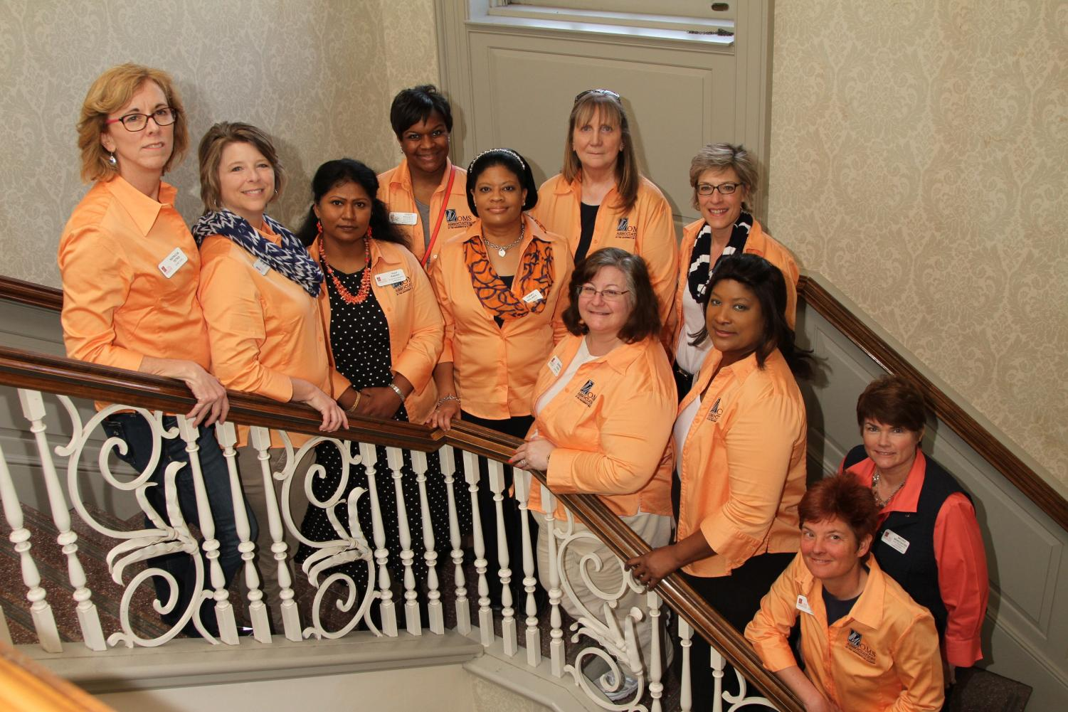 Members of the Moms Association pose in the Union in their group shirts.