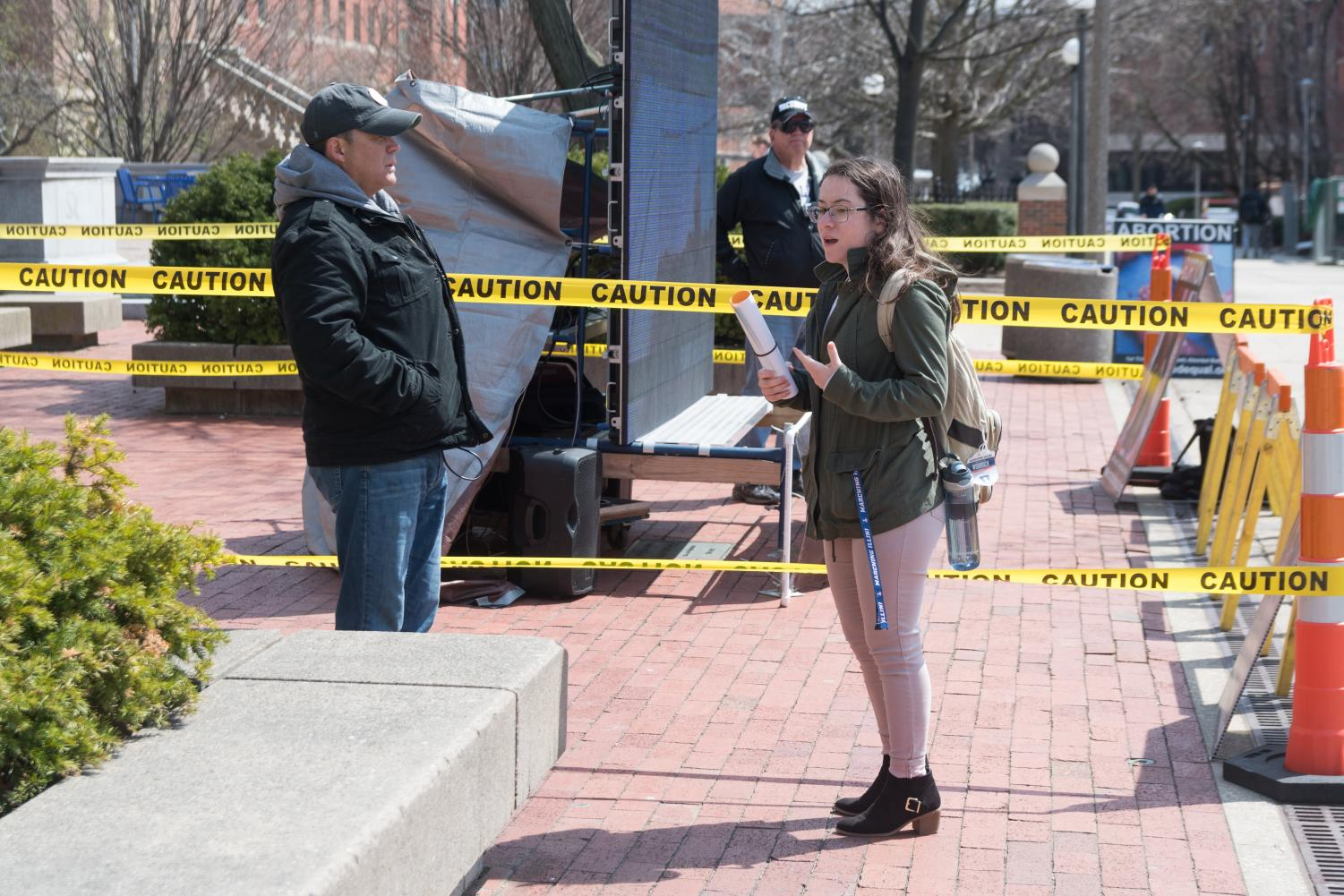 A University student challenges the pro-life activists' methods during a protest outside the Illini Union on Wednesday.