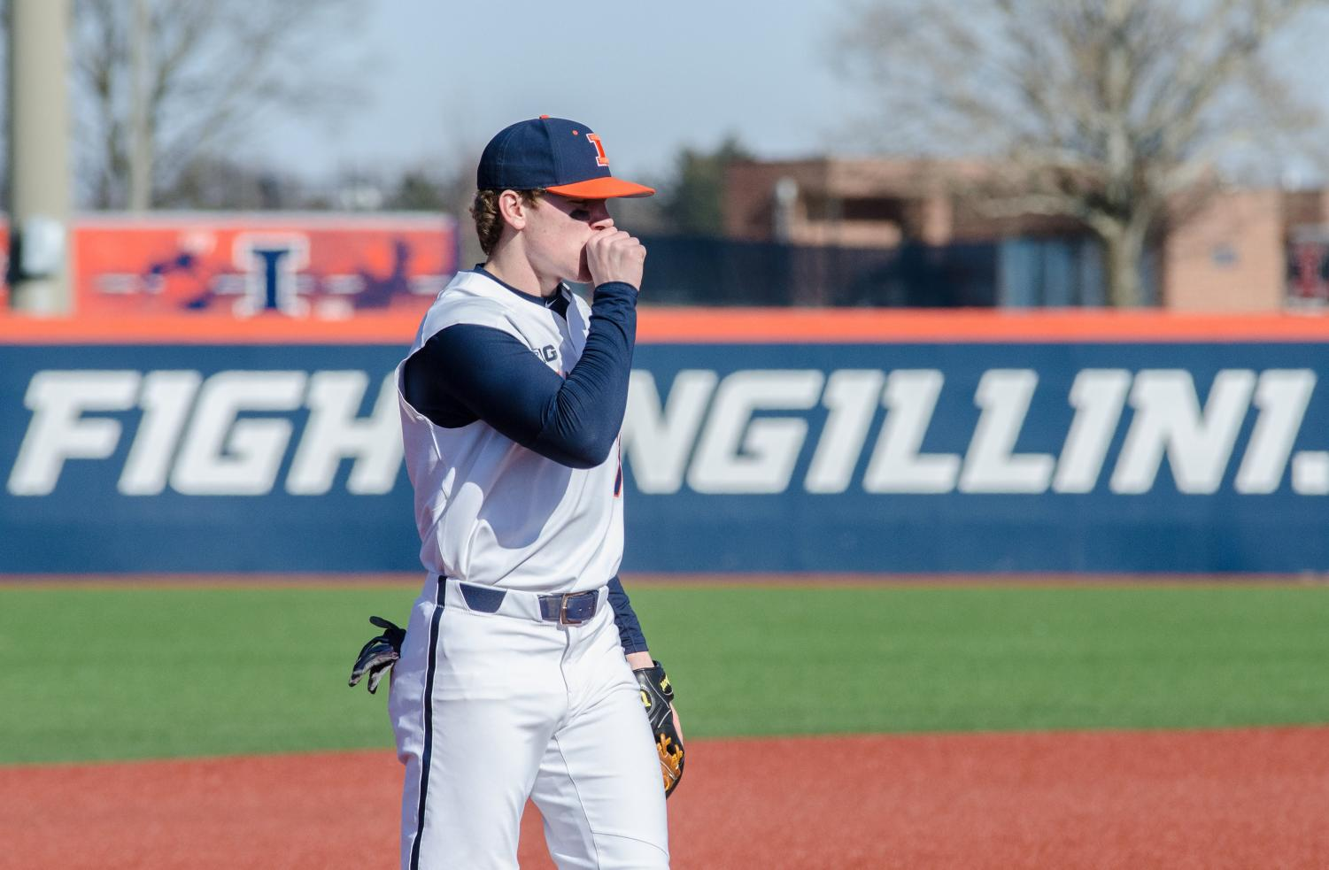 Grant Van Scoy warms his throwing hand during Illinois' 9-6 win against Milwaukee on Wednesday, March 14.