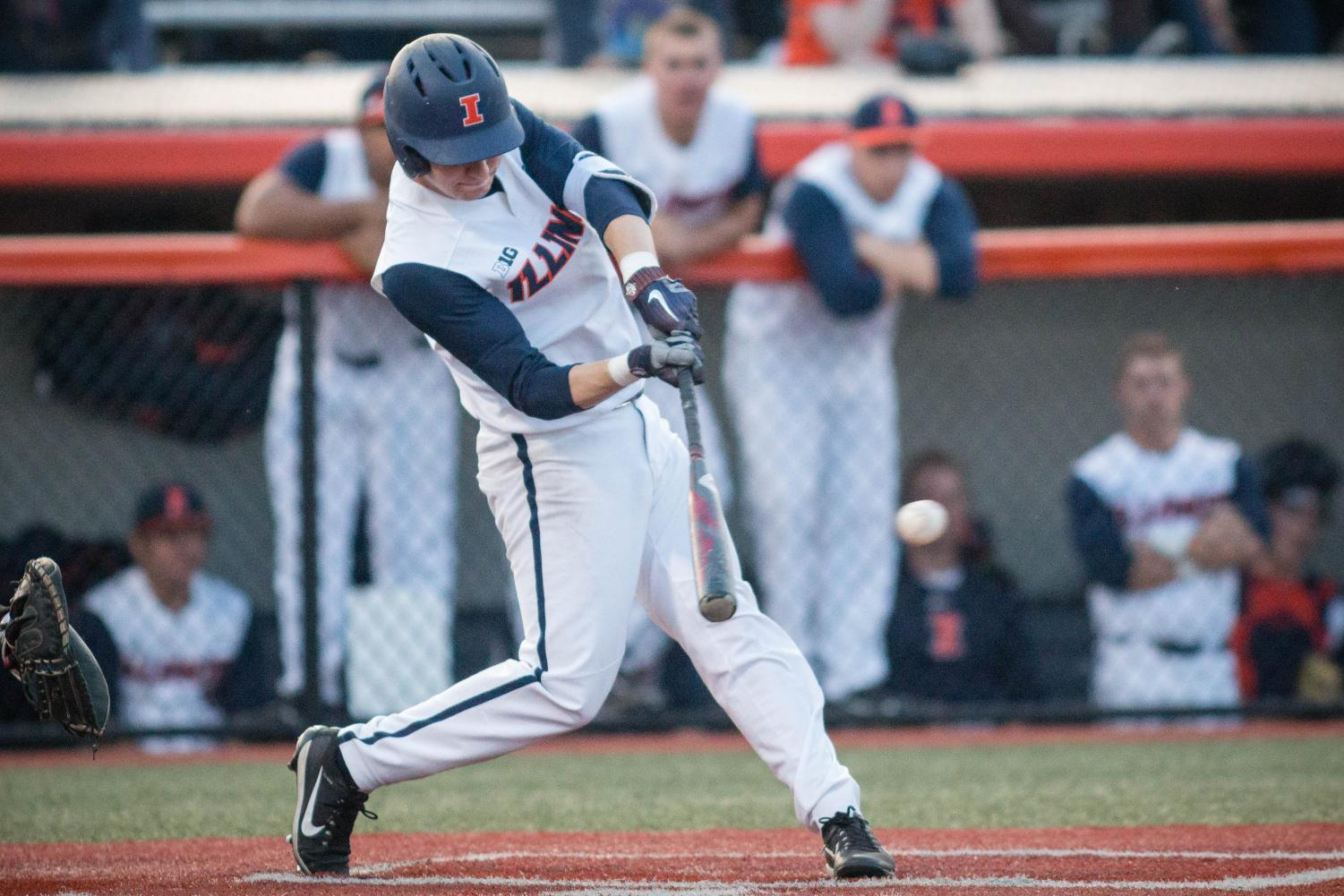 Illinois infielder Ben Troike hits the ball during the game against Rutgers at Illinois Field on Friday. The Illini won 13-12.