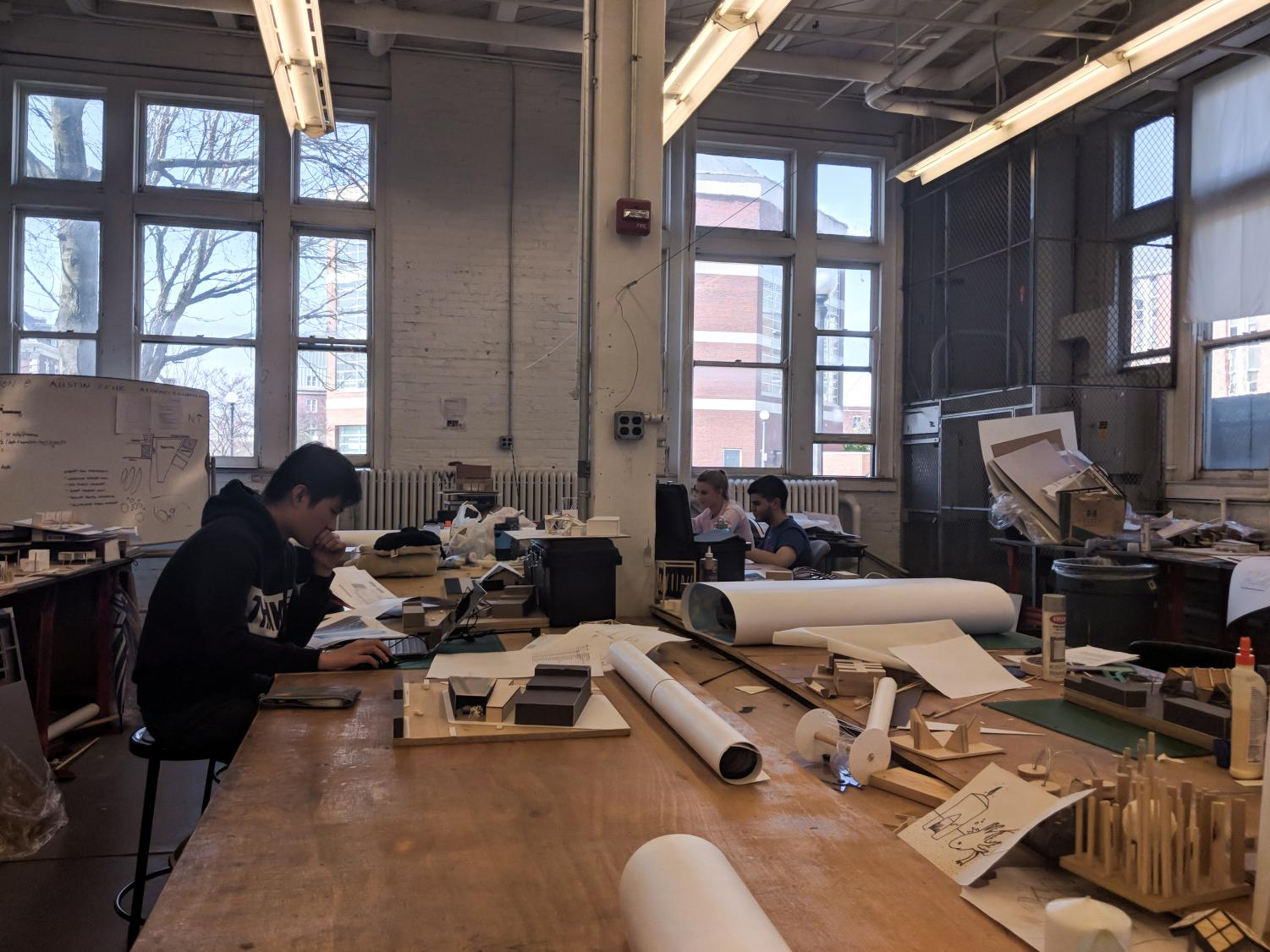 Three sophomores in architecture major are working in the Architecture Annex Studio, 1206 W peabody Dr, Urbana, IL. They are Jasson Partugi, Gabi Zenmaitis, and Miguel Perez (From left to right).