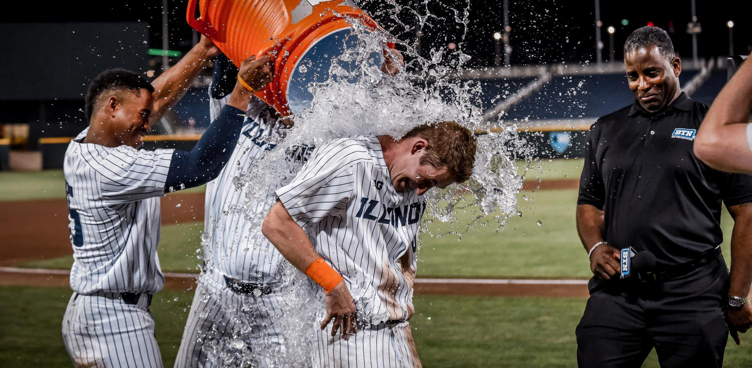 Ben Troike gets a shower from the team's water cooler after hitting a walk-off shot in Illinois' Friday night match-up against Indiana. The Illini won 5-4.