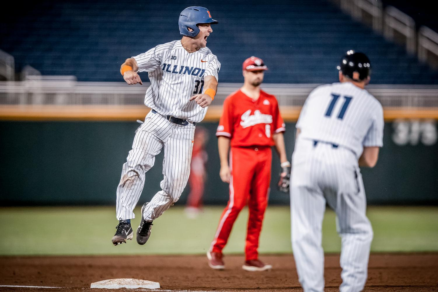 Illini center fielder Zac Taylor jumps at second base as the Illini battle Indiana at TD Ameritrade Park in Omaha, Nebraska on Saturday. Illinois went on to win 5-4 and advance to the semifinals of the Big Ten Tournament where they later lost to Purdue 11-5.