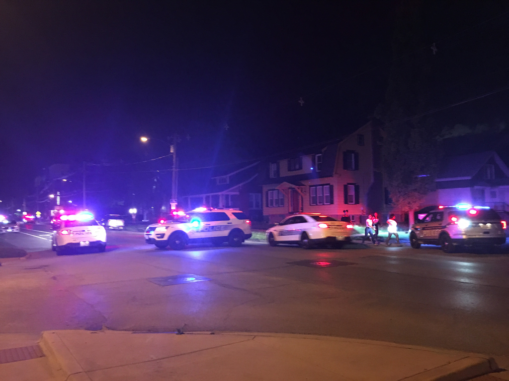 Police cars near the scene of the shooting around 1 a.m. on May 13. A suspect, 20-year-old Devon Cooper from Danville, Illinois, has been arrested by the Champaign Police Department in relation to the case.