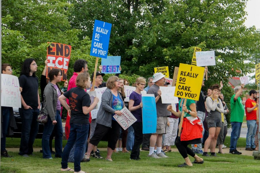 Hundreds+of+protestors+march+on+Prospect+Avenue+in+Champaign+Saturday.+The+protest+rallied+against+alleged+ICE+agents+staying+in+a+local+hotel.