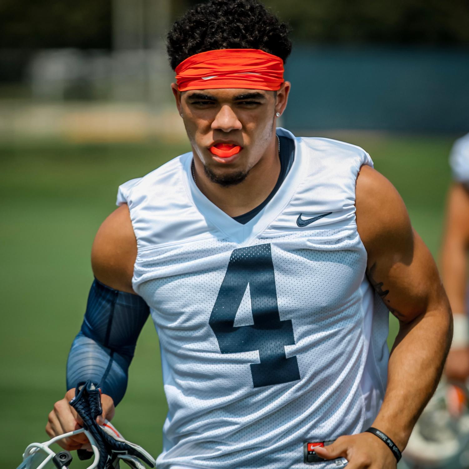 Sophomore defensive back Bennett Williams warms up during Illinois football training camp on Friday. Williams highlights a secondary that heads into the 2018 season with a lot young talent.
