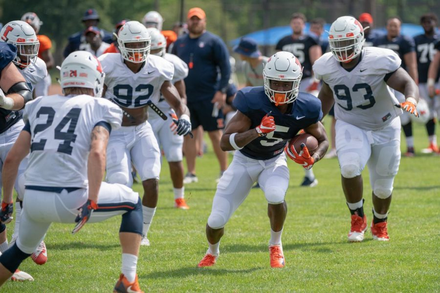 Illinois sophomore wide receiver Carmoni Green tries to avoid defenders after making a catch at Illinois training camp on August 8, 2018. Green looks  to have a strong season after an underwhelming freshman year. Photo by: Illini Athletics