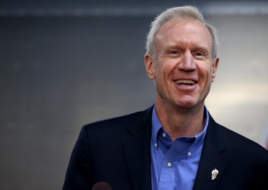 Governor+Bruce+Rauner+speaks+out+during+a+press+conference+for+an+announcement+of+a+donation+from+AptarGroup+and+Adapt+Pharma%2C+Thursday%2C+Feb.+8%2C2018.++The+donation+will+go+to+help+prevent+opioid+deaths.++
