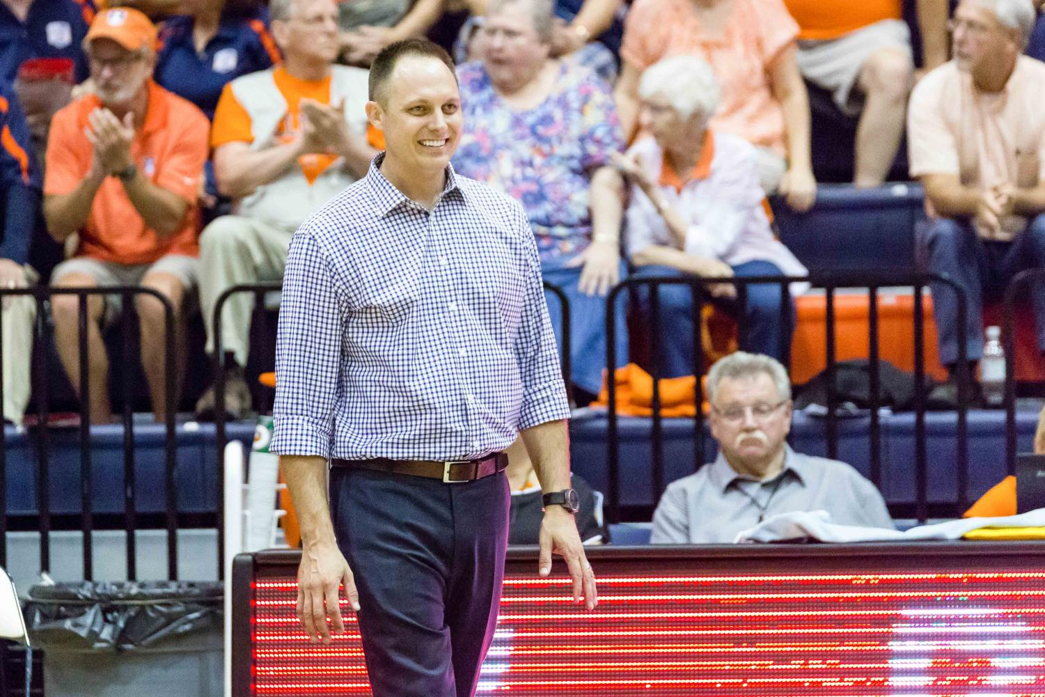 Illinois head coach Chris Tamas watches his team from the sideline during the match against Stanford at Huff Hall on Friday, September 8. The Illini lost 3-0.