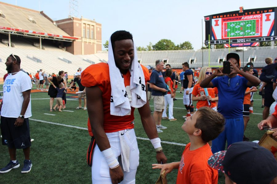 Grad-transfer+quarterback+AJ+Bush+meets+with+fan%27s+after+the+final+Illini+football+training+camp+practice+was+held+at+Memorial+Stadium+on+August+18%2C+2018.+Bush+has+been+a+standout+during+training+camp+and+is+expected+to+be+named+the+team%27s+starting+QB+for+the+season.+Photo+by%3A+Eli+Schuster
