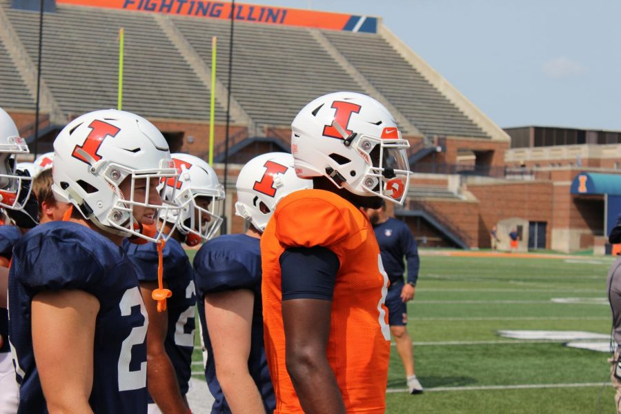 Freshman quarterback M.J. Rivers stands in front of teammates on the sideline during the last Illini football training camp on August 18, 2018. Illinois now heads into the season looking to improve on a 2-10 record with plenty of new and returning young players. Photo by: Eli Schuster
