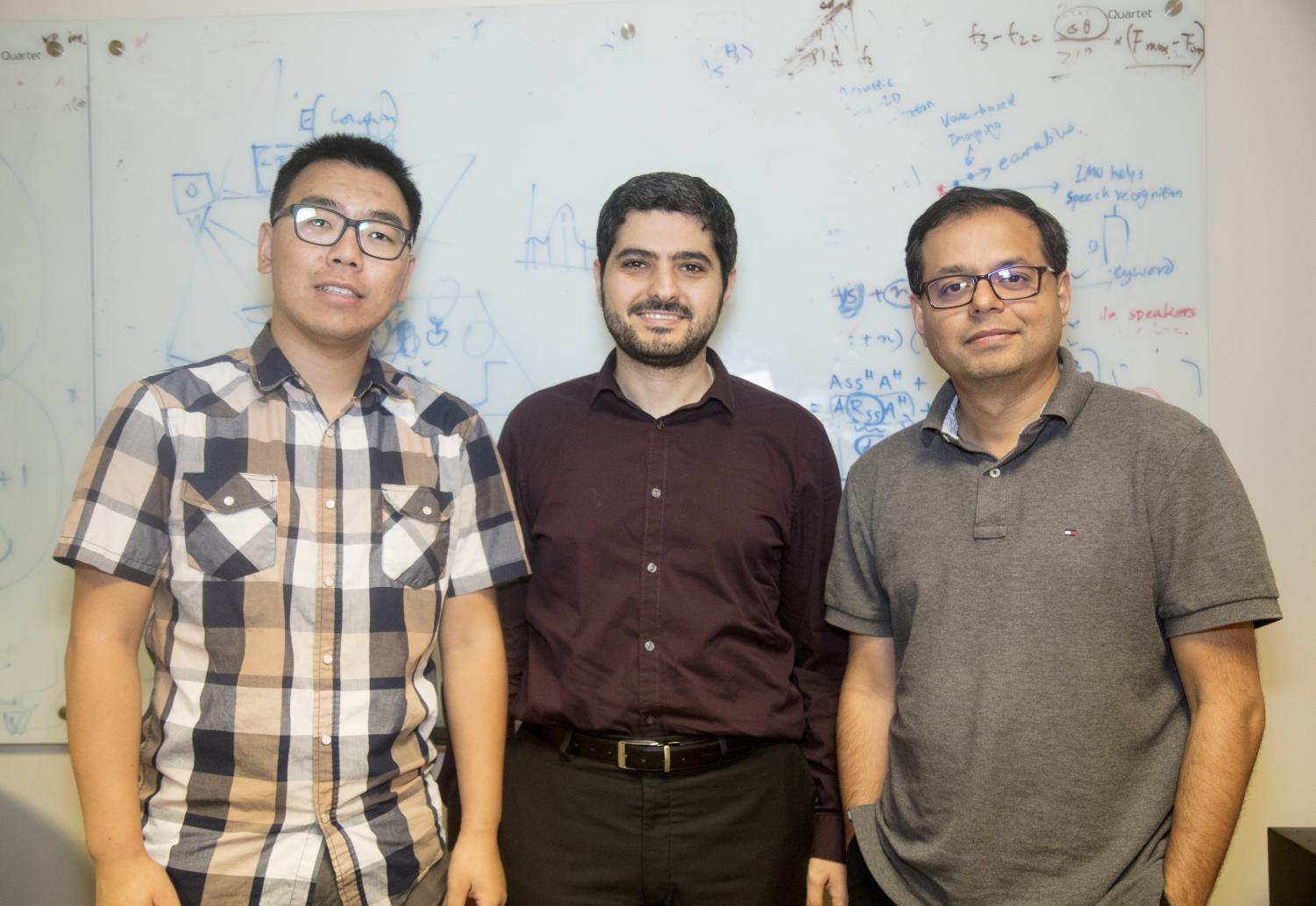 Sheng Shen, Romit Roy Choudhury and Haitham Al-Hassanieh together at CSL 241 after discussing their research with their team.