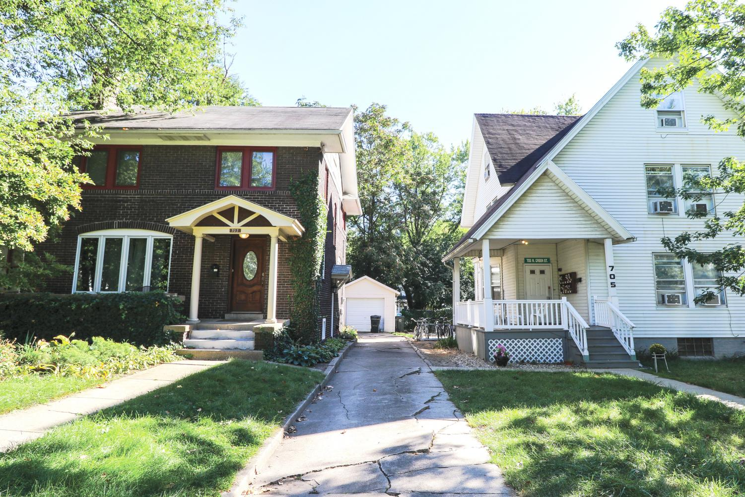 The view of two houses on the 700 block of West Green Street in Urbana. There are many houses in Urbana that are available for students to rent for the duration of the school year. Rachael Bolek, managing editor for online, says there are different pros and cons to living in a house versus an apartment.