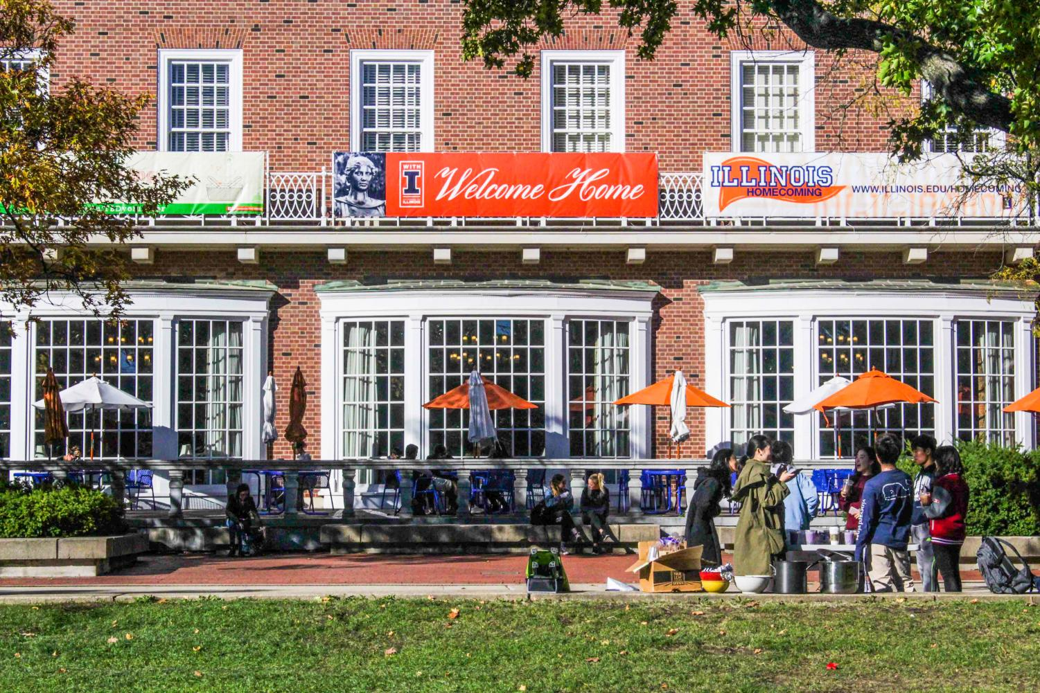 Students sit in front of the Illini Union as Homecoming 2017 begins on Oct. 26.