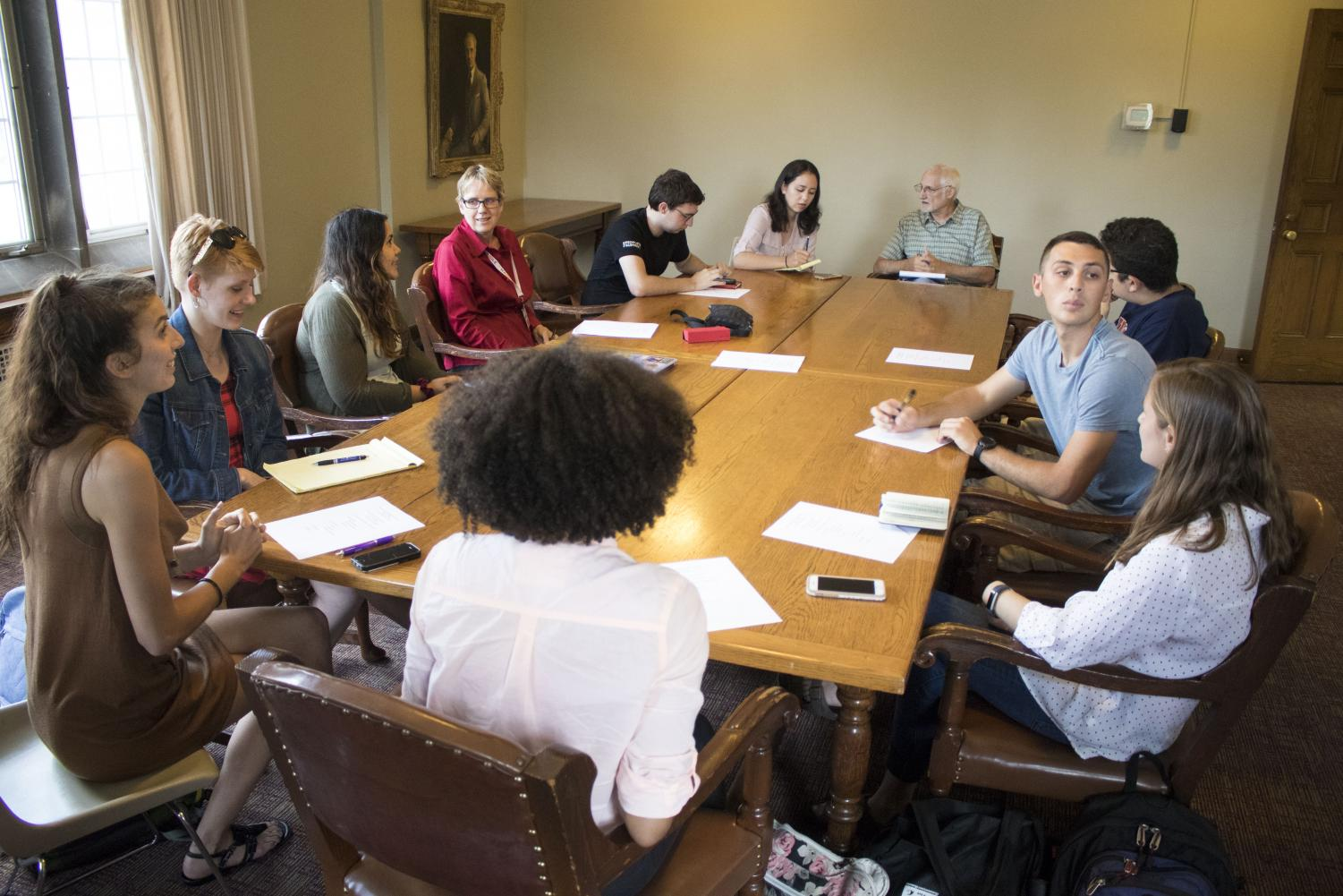 Representatives from different UIUC groups hold a meeting at the YMCA on Thursday to work together to increase the number of students registered to vote.