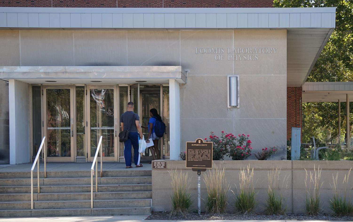 People enter Loomis Laboratory of Physics at 1110 W. Green St, where the Department of Physics is located, on Wednesday. Students will have chances to participate in the research and innovation activities through the Institute for Research and Innovation in Software for High-Energy Physics. Data from the research will also boost physics discoveries when the High-Luminosity Large Hadron Collider starts operating in 2026.