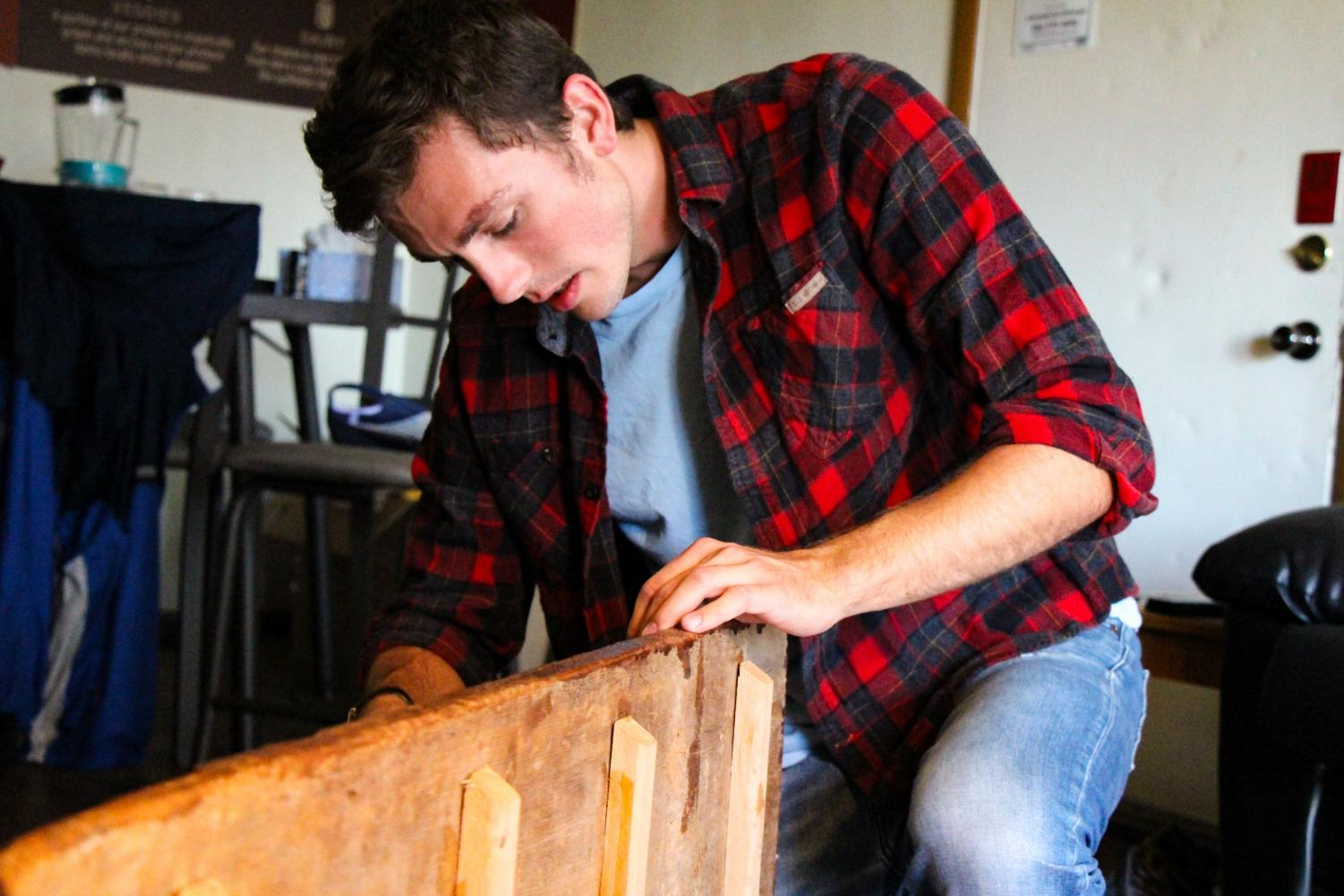 John Bieber, junior in ACES, builds furnitures for friends and family at his apartment on Tuesday. In recent years, he began commission work and uses his apartment on campus as a temporary studio while working on the main pieces at his house in the suburbs.