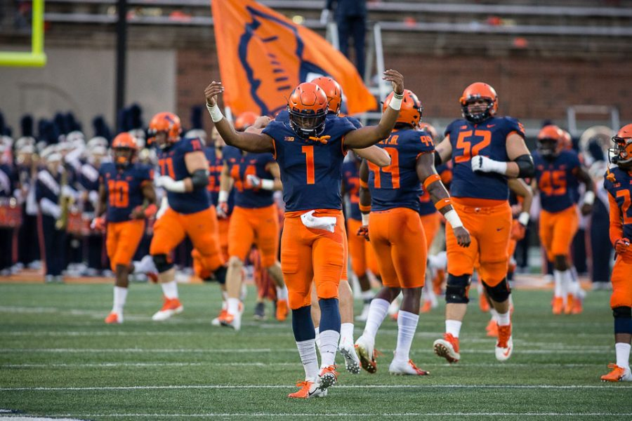 Illinois+quarterback+AJ+Bush+%281%29+celebrates+while+running+onto+the+field+at+the+start+of+the+game+against+Western+Illinois+at+Memorial+Stadium+on+Saturday%2C+Sept.+8%2C+2018.