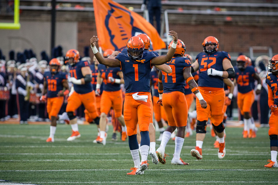 Illinois quarterback AJ Bush (1) celebrates while running onto the field at the start of the game against Western Illinois at Memorial Stadium on Saturday, Sept. 8, 2018.