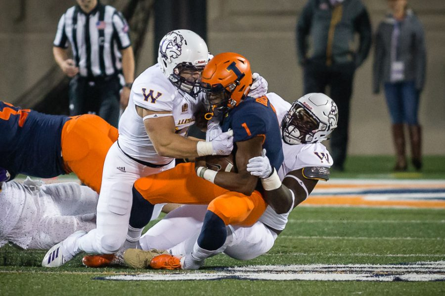 Illinois+quarterback+AJ+Bush+%281%29+gets+tackled+during+the+game+against+Western+Illinois+at+Memorial+Stadium+on+Sept.+8.