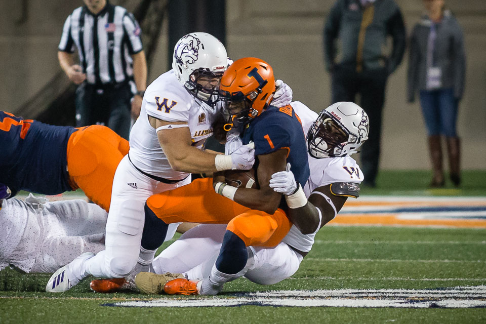 Illinois quarterback AJ Bush (1) gets tackled during the game against Western Illinois at Memorial Stadium on Sept. 8.