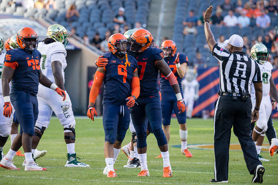Illinois linebacker Dele Harding (9) celebrates with defensive lineman Bobby Roundtree (97) after making a tackle during the game against USF at Soldier Field on Saturday, Sept. 15, 2018.