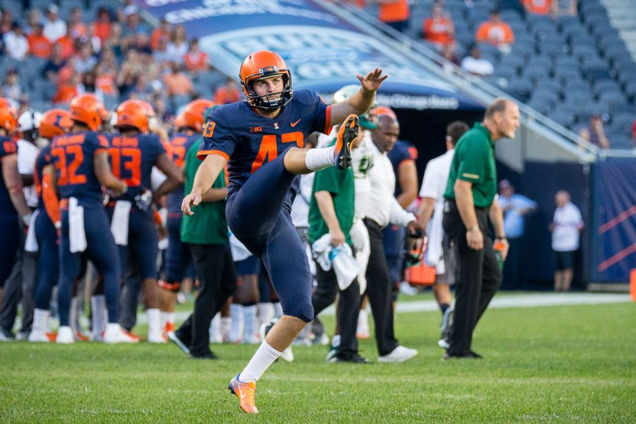 Illinois kicker Chase McLaughlin practices during a timeout in the game against USF at Soldier Field on Saturday. McLaughlin went 4-for-4 in the game and is the first kicker in Illini history to have three consecutive games with a 50-plus yard field goal.