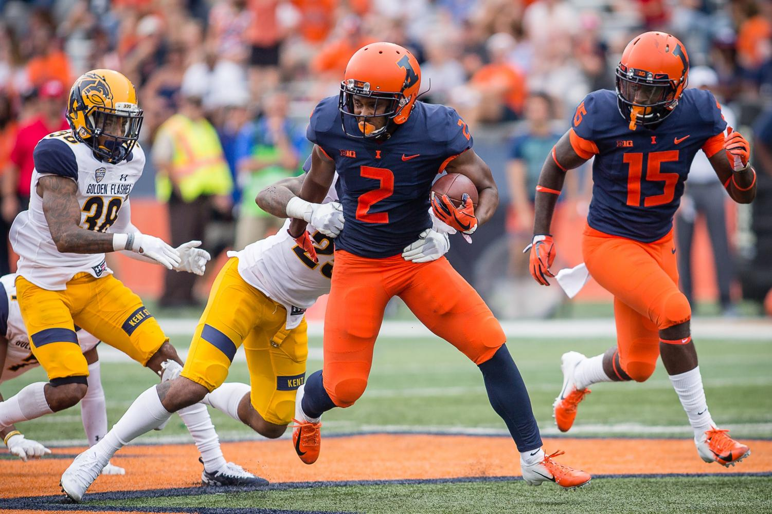 Illinois running back Reggie Corbin shakes off a defender during the game against Kent State at Memorial Stadium on Saturday. Corbin looks to be a big part of this year's offense.
