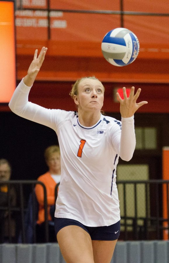 Jordyn+Poulter+begins+her+serve+during+Illinois%E2%80%99+game+against+Wisconsin+on+Nov.+17.
