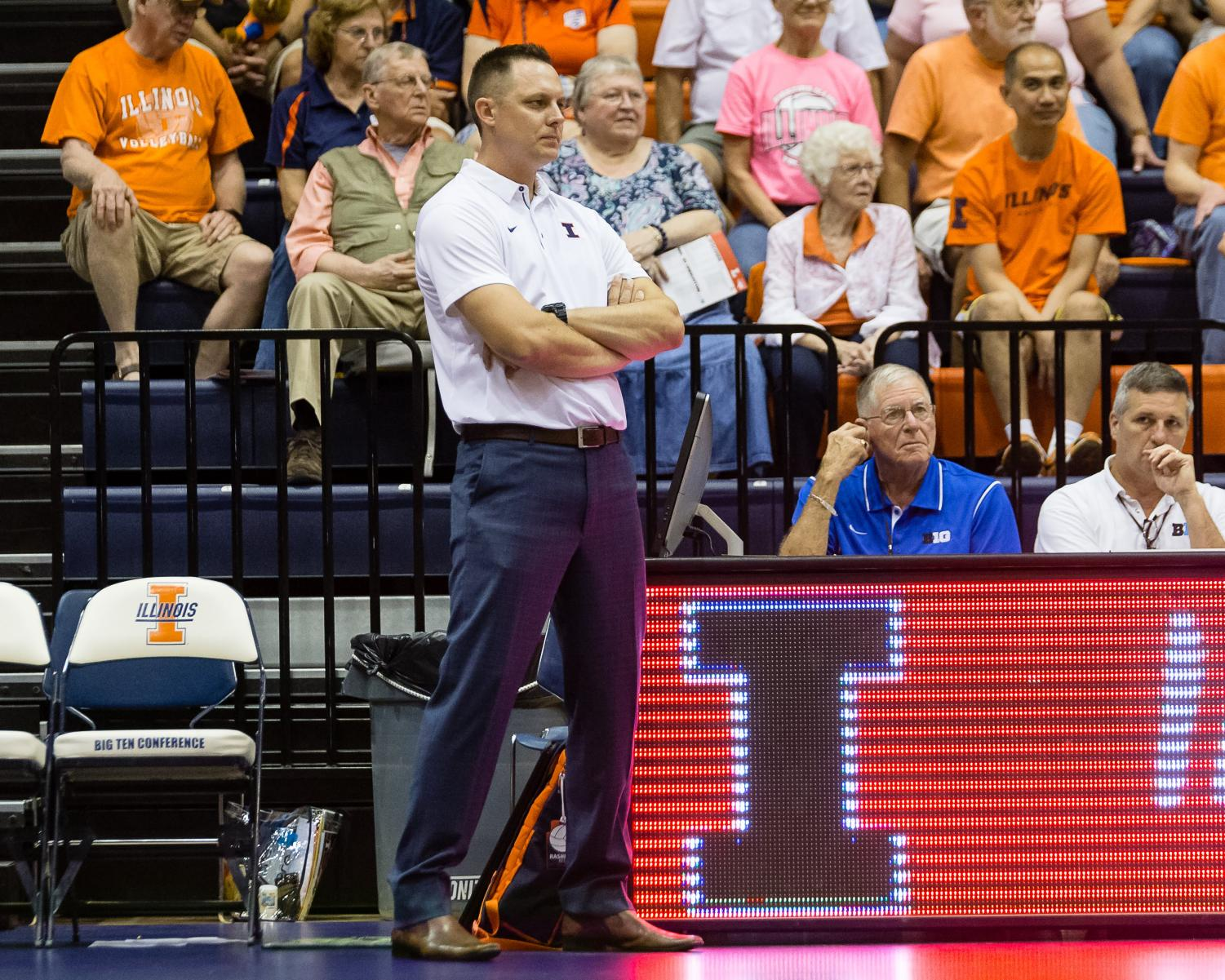 Illinois head coach Chris Tamas watches his team from the sideline during the match against Northern Iowa at Huff Hall on Friday. Illinois now looks ahead to Big Ten play.