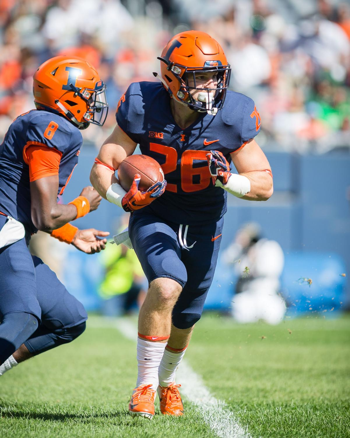 Illinois running back Mike Epstein runs the ball during the game against USF at Soldier Field on Saturday. The Illini lost 25-19.