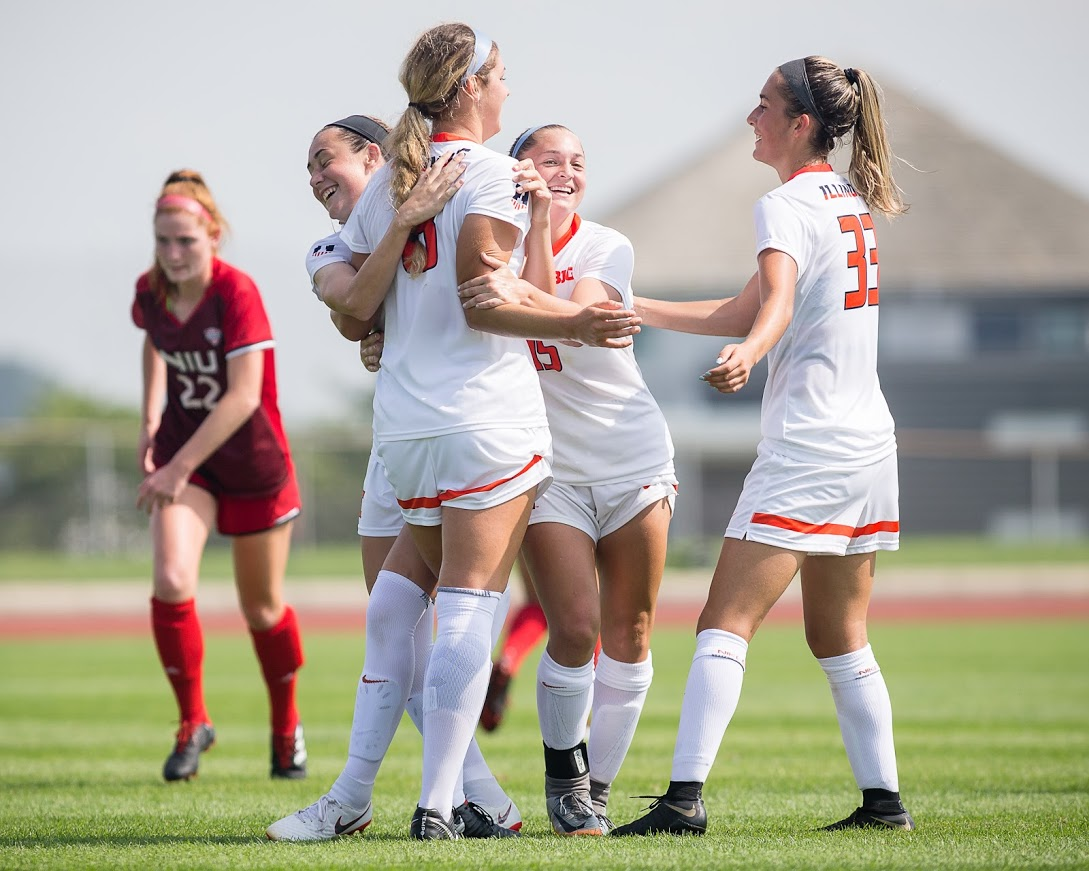 Illinois midfielder Hope Breslin (10), forward Kelly Maday (15), and defender Ashley Cathro (33) celebrate with forward Caroline Ratz (8) after a goal during the game against Northern Illinois at the Illinois Soccer Stadium on Sunday, Aug. 26, 2018. The Illini won 8-0.