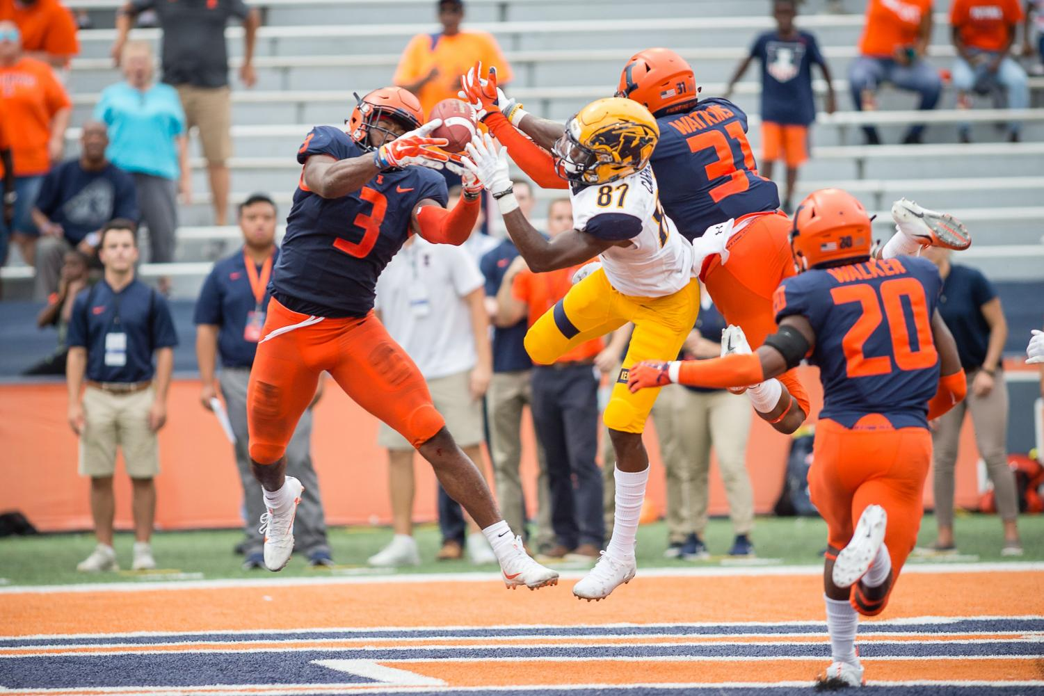Illinois linebacker Del'Shawn Phillips intercepts a pass during the game against Kent State at Memorial Stadium on Sept. 1. Phillips has been a leader on defense, grabbing two interceptions this season.