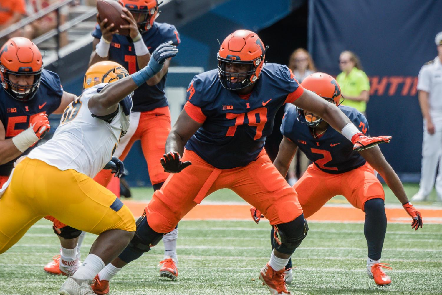 Offensive lineman Vederian Lowe prepares for a block against Kent State last Saturday. Despite a  rst-half struggle, with several missed blocks and a lack of communication, Lowe and his fellow linemen made halftime adjustments to help lead Illinois to a 31-24 victory.