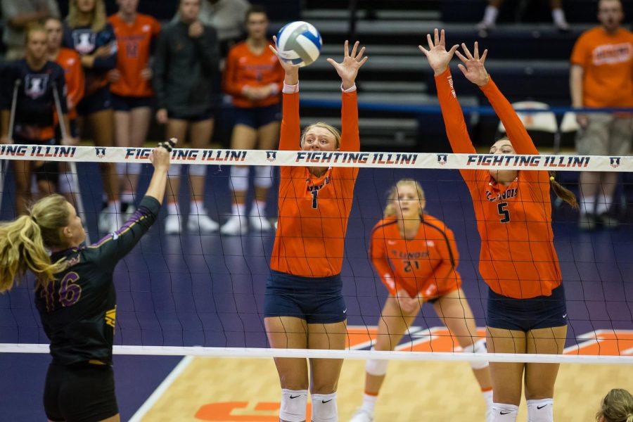 Illinois+setter+Jordyn+Poulter+%28left%29+and+middle+blocker+Ali+Bastianelli+%28right%29+attempt+to+block+the+ball+during+the+match+against%0ANorthern+Iowa+at+Huff+Hall+on+Friday.+The+Illini+won+3-0.