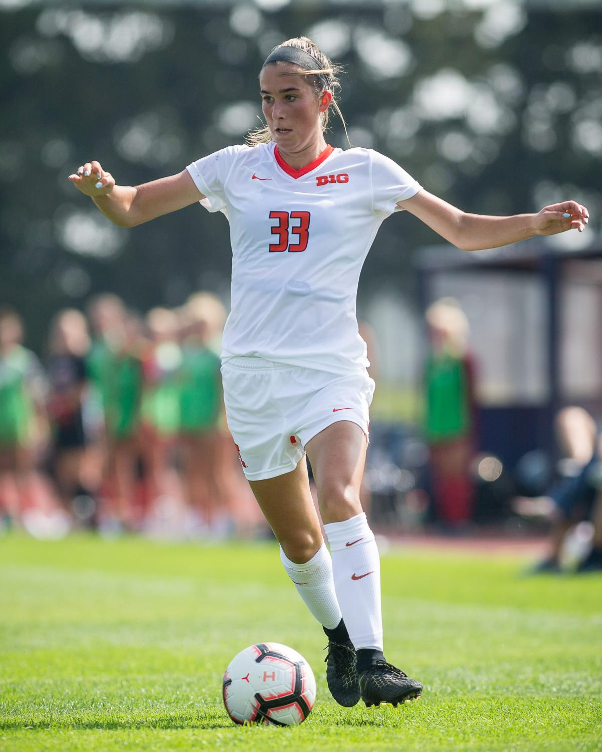 Illinois defender Ashley Cathro (33) dribbles the ball during the game against Northern Illinois at the Illinois Soccer Stadium on Sunday, Aug. 26, 2018. The Illini won 8-0.