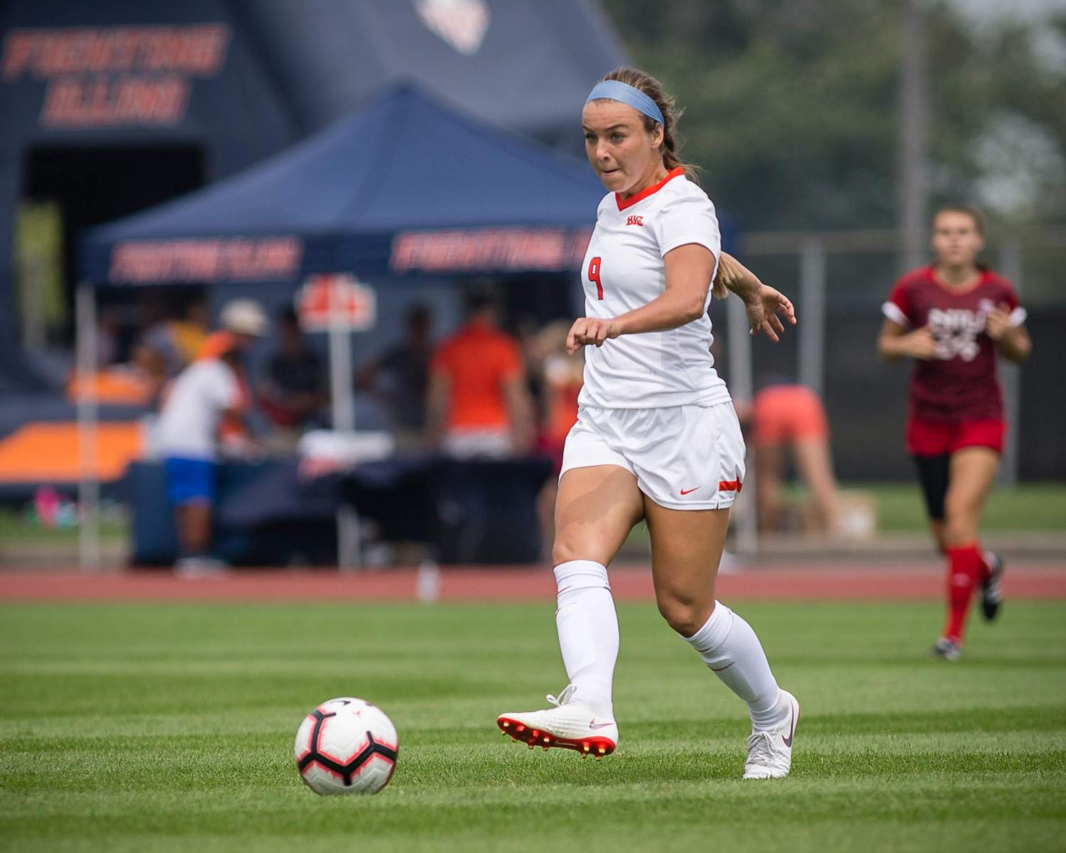 Illinois midfielder Lauren Ciesla (9) passes the ball during the game against Northern Illinois at the Illinois Soccer Stadium on Sunday, Aug. 26, 2018. The Illini won 8-0.